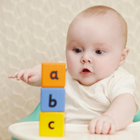 Baby girl with alphabet blocks