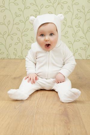 floorboards: Little girl in babygro with ears