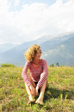 whimsy: Woman sitting on rural hilltop