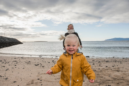 trouble free: Grandmother and toddler at coast