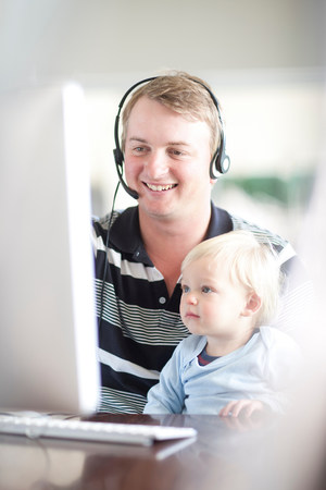 casual clothing 12 year old: Father with baby boy using computer
