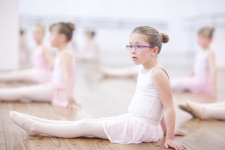 top 7: Distracted young ballerina sitting on floor