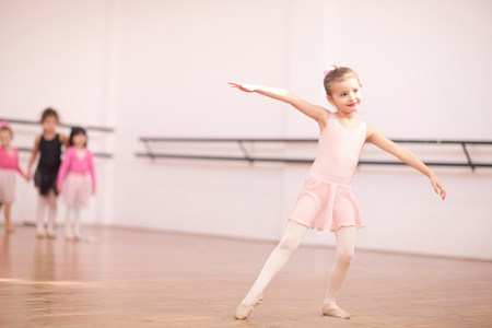 pinks: Young ballerina posing in class
