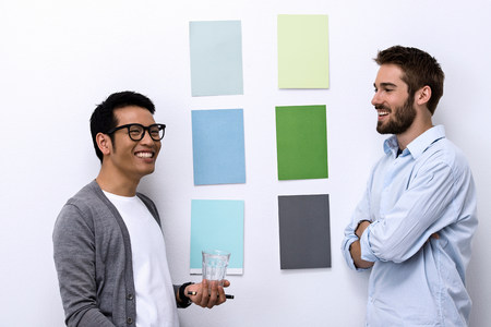 customer facing: Male designers standing in front of color swatch