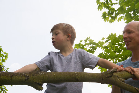 6 year old: Father and son climbing tree
