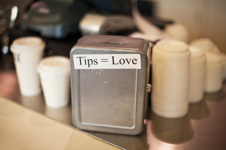 persuasiveness: Close up of cafe tip box
