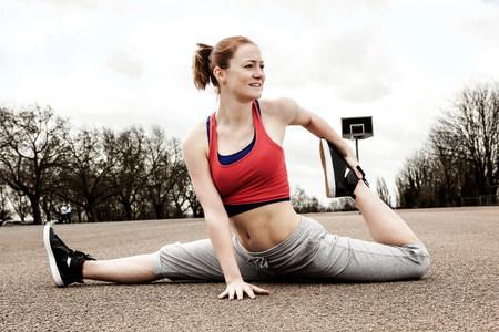 Woman doing splits with left leg bent backwards