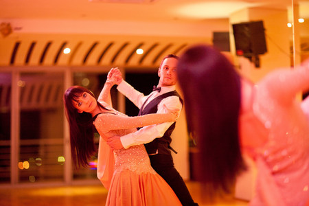 Young ballroom dancers practising in mirror