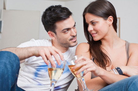 chillout: Romantic young couple sharing glass of wine