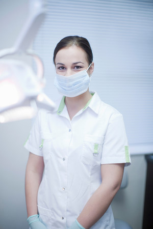 gloved: Portrait of a young dental nurse wearing surgical mask LANG_EVOIMAGES