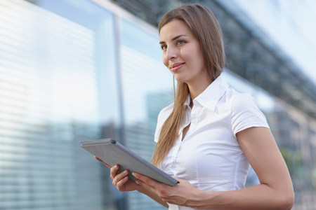 Young businesswoman using digital tablet,smiling