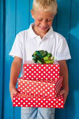 Boy looking down at gifts LANG_EVOIMAGES