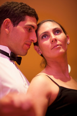 Mid adult woman and young man posing in dance class,close up