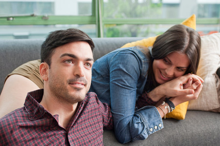 parlours: Young couple lounging on sofa