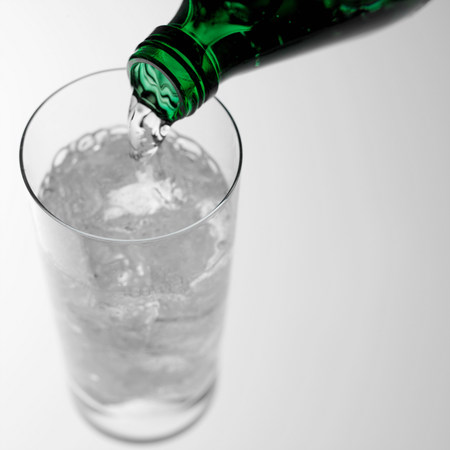 refreshed: Pouring sparkling water into glass LANG_EVOIMAGES