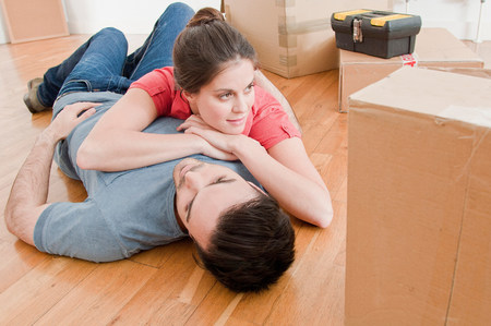 parlours: Young couple taking a break amongst cardboard boxes