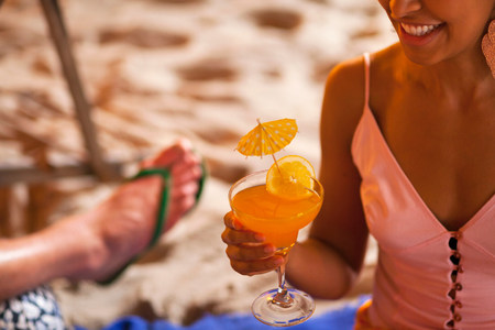 Close up of young woman holding cocktail
