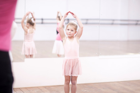 Young ballerinas posing in dance studio