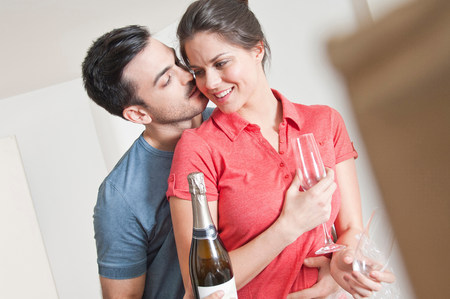 parlours: Young couple celebrating with champagne