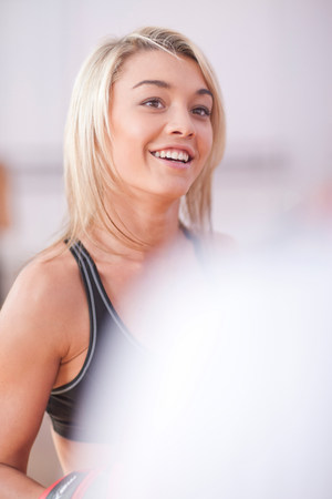 Portrait of young woman in gym
