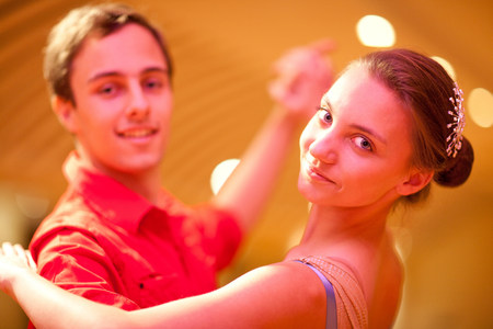Young man and teenage girl ballroom dancers,portrait