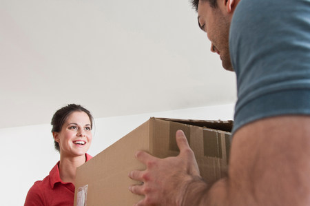 parlours: Young couple with cardboard box