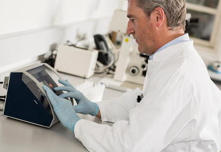 engrossed: Scientist using laboratory equipment