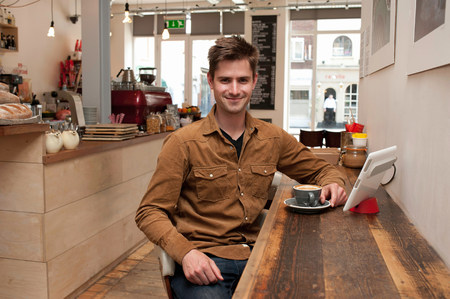 worktops: Portrait of young man with coffee and digital tablet in cafe LANG_EVOIMAGES