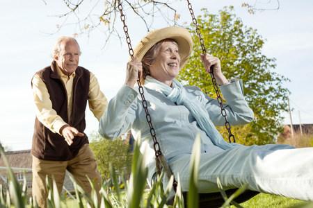 60 64 years: Husband pushing wife on swing