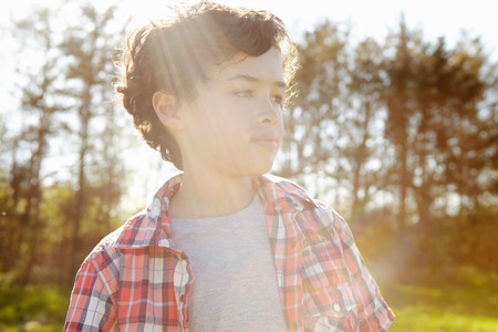 preadolescent: Boy wearing checked shirt in park