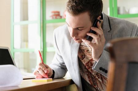 Man taking phone message