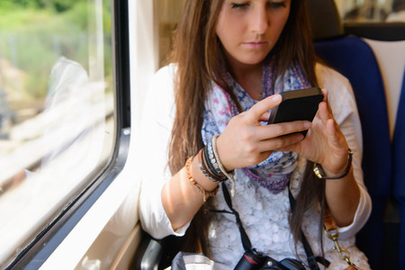 sweatshirt: Young female tourist on traveling on local train,Catalonia,Spain LANG_EVOIMAGES