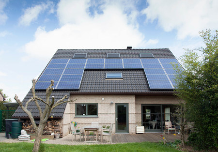 environmentalism: Detached bungalow with solar panels on roof