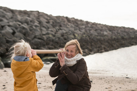 anorak: Grandmother and toddler having fun at coast