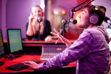 purples: Young man and woman broadcasting in recording studio