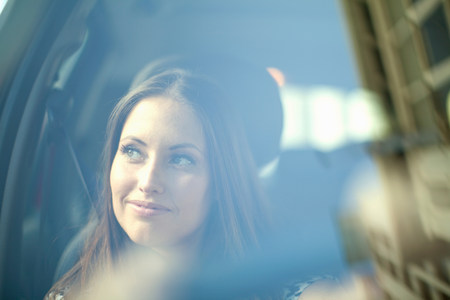 capetown: Young woman looking out of car window LANG_EVOIMAGES