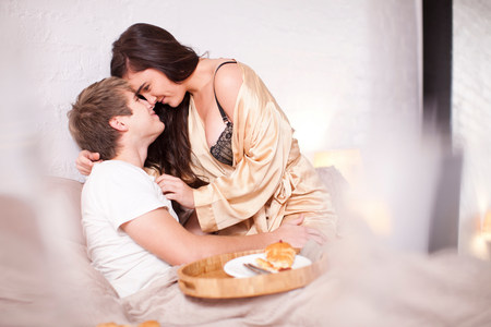 Romantic young couple on bed
