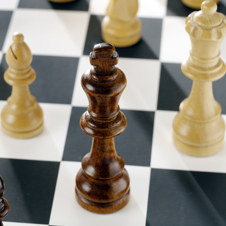 vintage: Close up of chess pieces on board LANG_EVOIMAGES