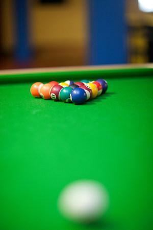 Set of undisturbed pool balls on table