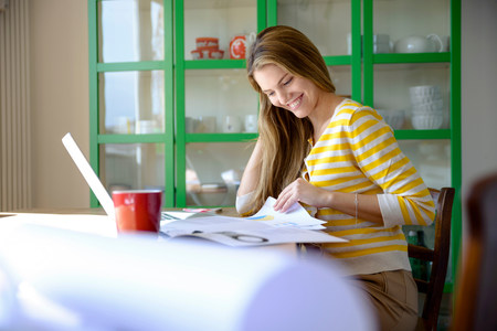 stripy: Young woman working from home