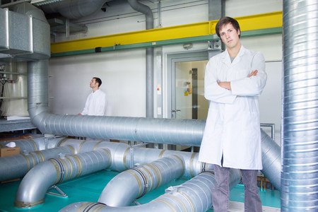 two persons only: Portrait of two scientists in technical laboratory