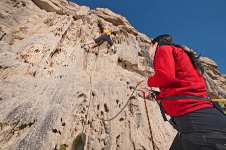 Two female rock climbers on cliff