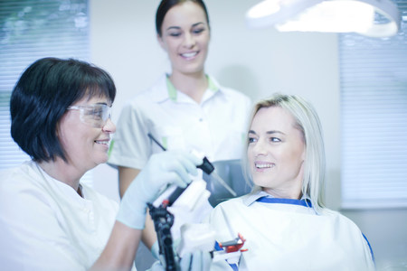 gloved: Dentist preparing to treat patient