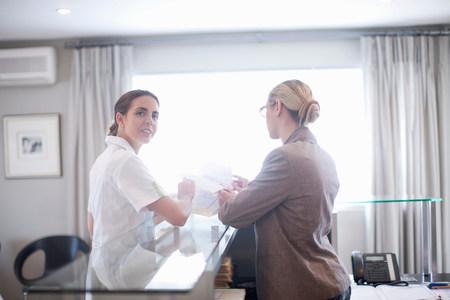 organised: Nurse and hospital receptionist LANG_EVOIMAGES