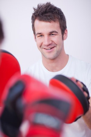 punched out: Close up of personal trainer in gym