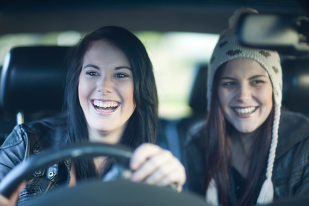two persons only: Two young women driving
