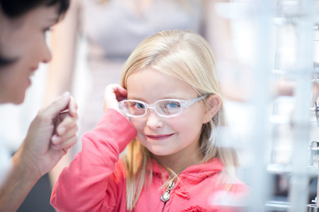 sight seeing: Young girl on choosing eyeglasses