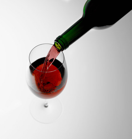 bodegones: Pouring red wine into glass