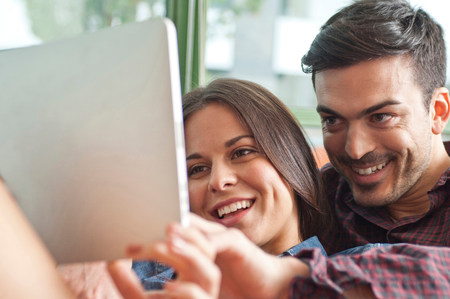 parlours: Young couple looking at digital tablet
