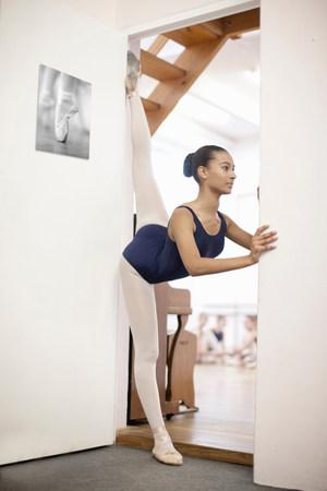 Portrait of teenage ballerina in doorway LANG_EVOIMAGES